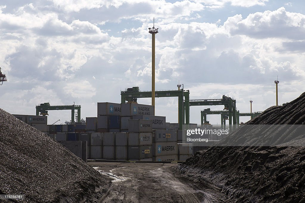 Shipping containers stand on the dockside between piles of coal in Yuzhny port, operated by TIS Group, near Odessa, Ukraine, on Friday, July 19, 2013. Ukraine wants to cut current-account deficit to 3%-4% of GDP in medium term, central bank official Serhiy Nikolaychuk tells reporters in Kiev. Photographer: Vincent Mundy/Bloomberg via Getty Images