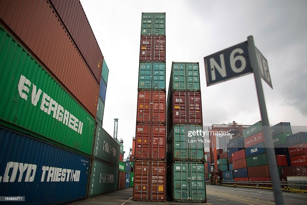 Shipping containers stand unattended during industrial action at the Kwai Chung Container Terminal on March 29, 2013 in Hong Kong, China. Over 100 workers, who are employed by Hongkong International Terminals, have taken strike action as they demand higher wages, claiming that that they have not received a pay raise in 15 years.