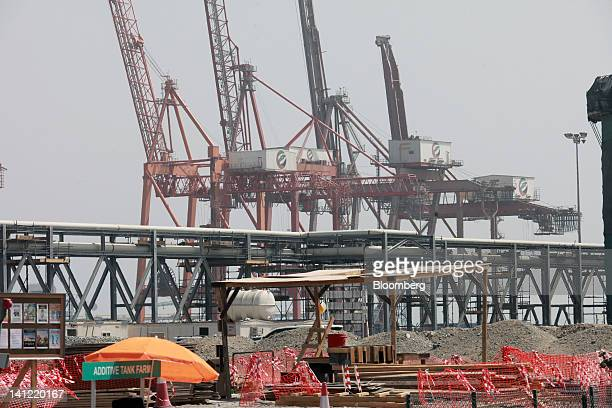 Shipping cranes operated by DP World Ltd stand near Chemoil pipes under construction inside Fujairah port in Fujairah United Arab Emirates on Monday...
