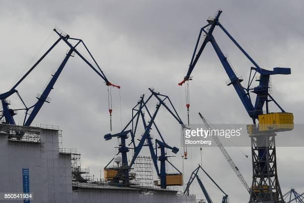 Shipping cranes stand at Blohm Voss maintenance shipyard at the Port of Hamburg in Hamburg Germany on Wednesday Sept 20 2017 Germany's Bundesbank...