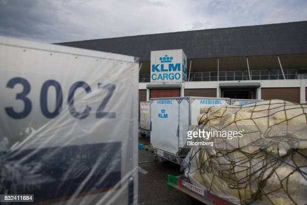 Shipping crates stand outside the KLM Cargo center operated by Air FranceKLM Group at Schiphol airport in Amsterdam Netherlands on Tuesday Aug 15...