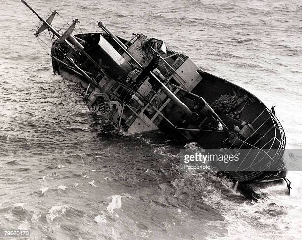Shipping Disasters 10th January 1952 Kurt Carlsen the Captain of the stricken freighter 'Flying Enterprise' clinging to the rails of the listing ship...