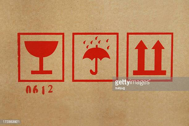 Shipping icons on cardboard box