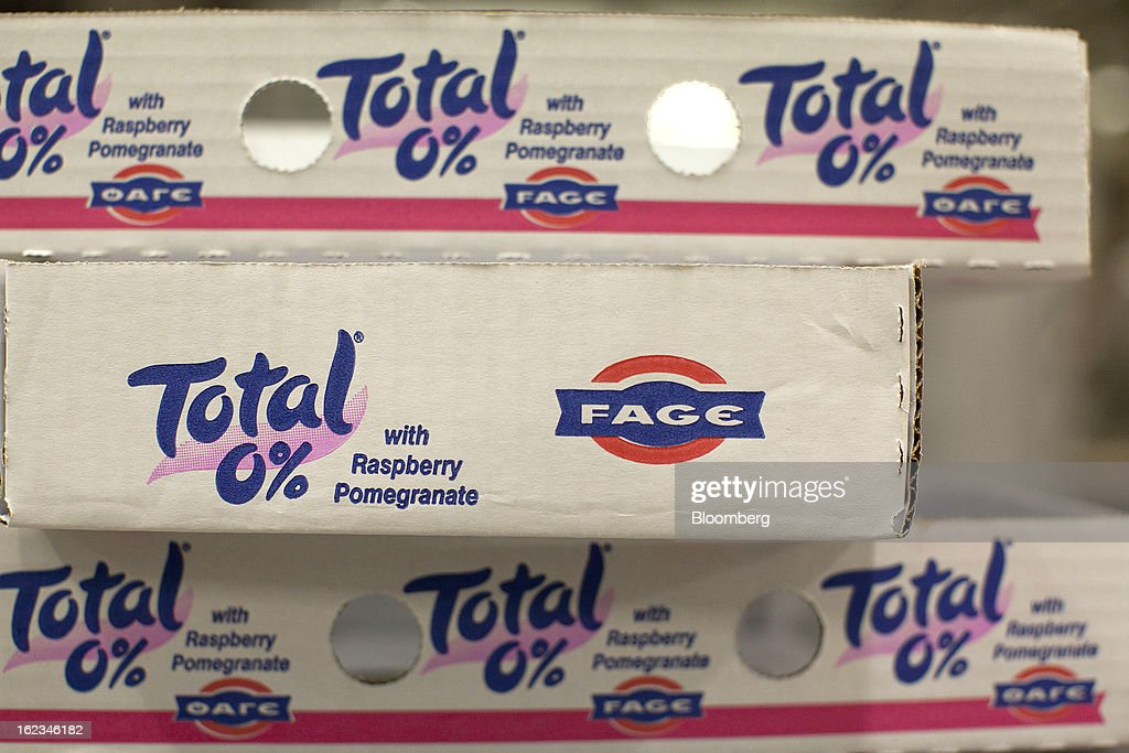 Shipping trays branded with Total yoghurt logos sit before use at the Fage Dairy Industry SA plant in Athens, Greece, on Thursday, Feb. 21, 2013. An October restructuring that placed Fage International SA's Greek units in a subsidiary called Fage Dairy Industry SA coincided with Coca-Cola Hellenic Bottling SA's plan to flee the epicenter of Europe's debt crisis by moving its main stock listing to London from Athens. Photographer: Kostas Tsironis/Bloomberg via Getty Images