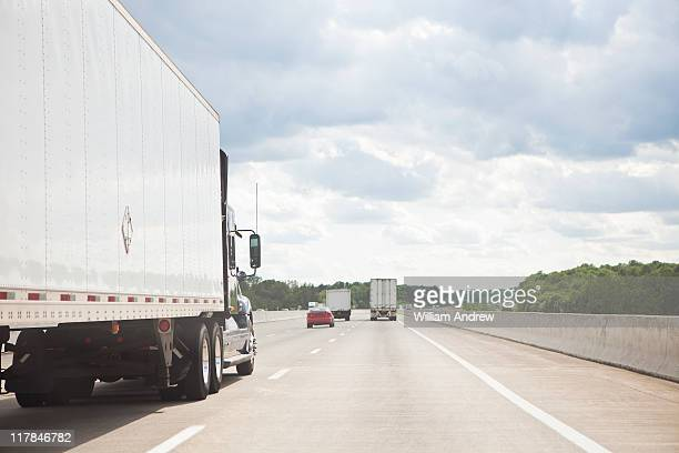 Shipping truck heading down highway