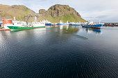 Ships anchored at Vestmannaeyjar harbour, Westman Islands archipelago, Iceland