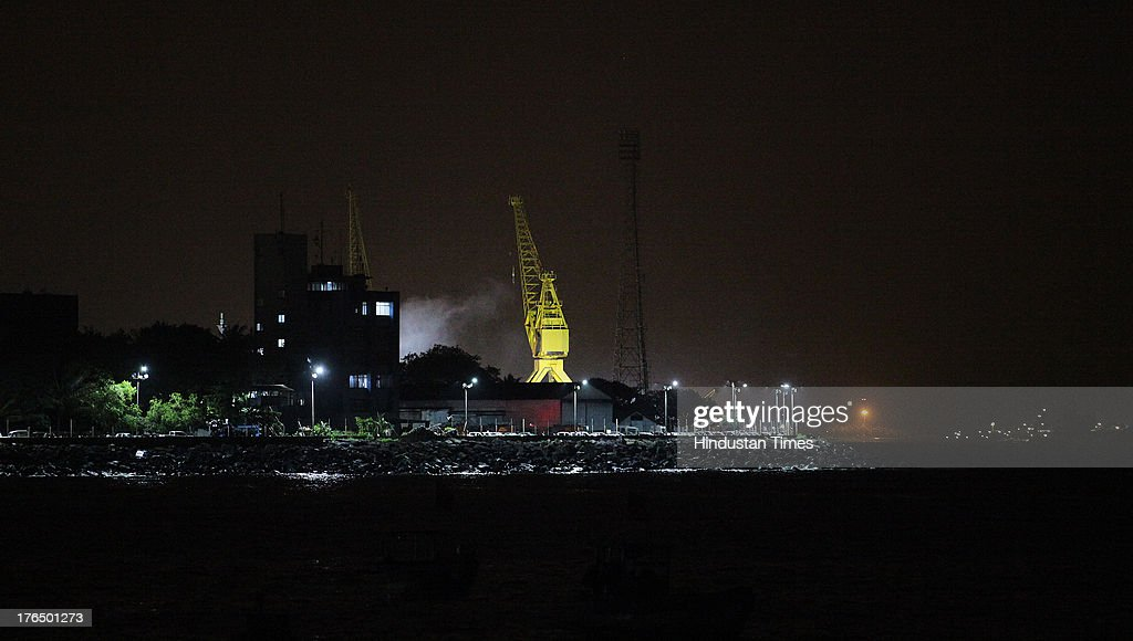 Ships and boats belonging to the Indian Navy are seen docked at the naval dockyard after an explosion on Indian submarine INS Sindhurakshak on August 14, 2013 in Mumbai, India. The blast followed by a fire occurred shortly after midnight on the Russia-made submarines, INS Sindhurakshak which sank soon after getting gutted. The details of other casualty figures were not immediately available though some injured sailors have been rushed to naval hospital INHS Ashvini in Colaba.