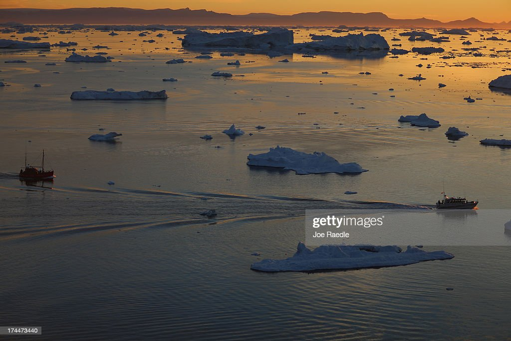 Ships are seen among the icebergs that broke off from the Jakobshavn Glacier as the sun reaches its lowest point of the day on July 23, 2013 in Ilulissat, Greenland. As the sea levels around the globe rise, researchers affilitated with the National Science Foundation and other organizations are studying the phenomena of the melting glaciers and its long-term ramifications. The warmer temperatures that have had an effect on the glaciers in Greenland also have altered the ways in which the local populace farm, fish, hunt and even travel across land. In recent years, sea level rise in places such as Miami Beach has led to increased street flooding and prompted leaders such as New York City Mayor Michael Bloomberg to propose a $19.5 billion plan to boost the citys capacity to withstand future extreme weather events by, among other things, devising mechanisms to withstand flooding.