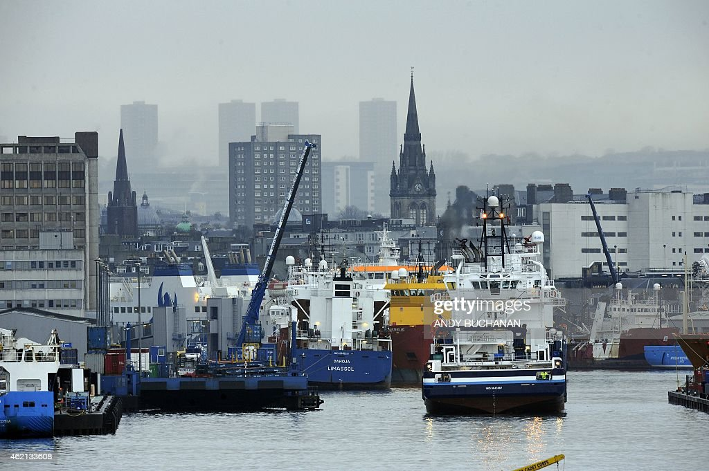 Ships are seen in Aberdeen Harbour the busiest port for the oil industry in the UK in Aberdeen Scotland on January 21 2015 On the docks in Aberdeen...