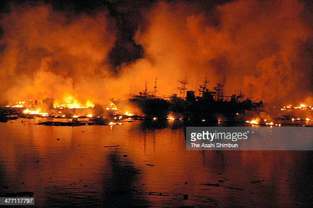Ships at Kesennuma Port are covered by fire after the Magnitude 90 strong earthquake and subsequent tsunami on March 11 2011 in Kesennuma Miyagi...