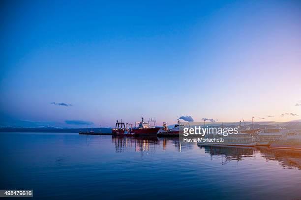 Ships at Ushuaia's harbor at sunset