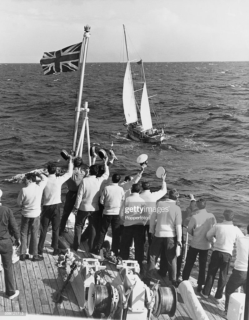 A ship's crew welcomes English sailor Robin Knox-Johnston on board his 32-foot (9.8-metre) boat Suhaili, as he nears Falmouth at the end of his circumnavigation of the earth, the first to be achieved single-handed and non-stop, 23rd April 1969.