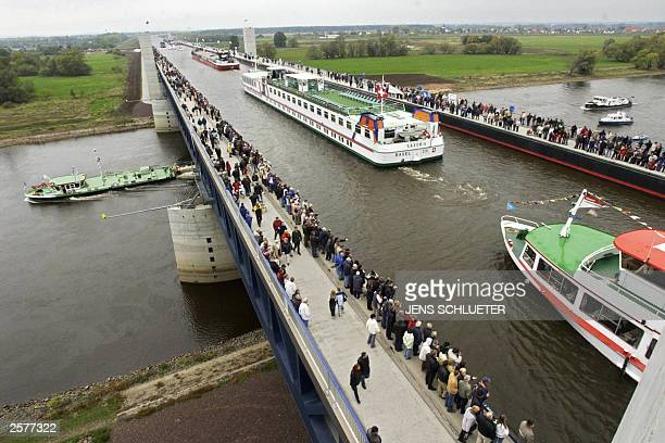Ships cross on the giant canal bridge 'Trogbruecke' the river Elbe 10 October 2003 near Magdeburg during the inauguration by German Transport...