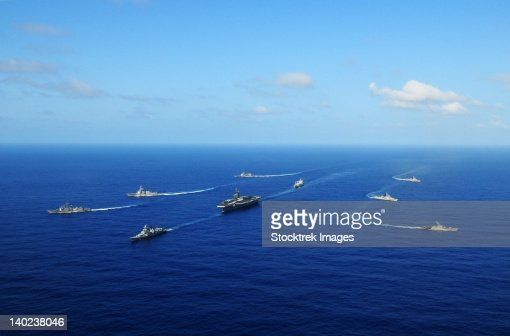 Ships from the Ronald Reagan Carrier Strike Group transit the Pacific Ocean. : Stock Photo