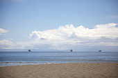 Ships in the distance at sea