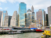 Ships on historic South Street Seaport and Pier 17, with lower Manhattan skyline in the back. New York City, USA