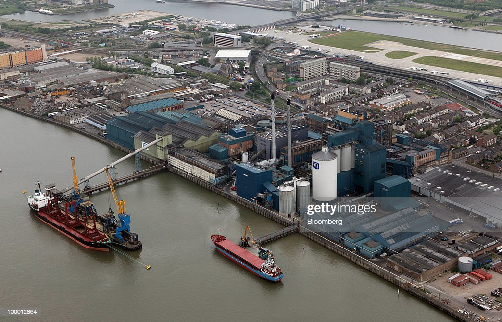 Ships sit moored at the Tate & Lyle sugar refinery on the banks of the River Thames in this aerial view in London, U.K., on Wednesday, May 19, 2010. Job vacancies at London financial-services companies fell 12 percent in April as Britain headed into elections that resulted in a coalition government and the European Union struggled to cut deficits. Photographer: Chris Ratcliffe/Bloomberg via Getty Images