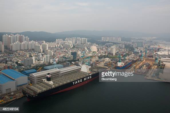 Ships stand under construction in this aerial photograph taken above the Hyundai Heavy Industries Co shipyard in Ulsan South Korea on Wednesday July...