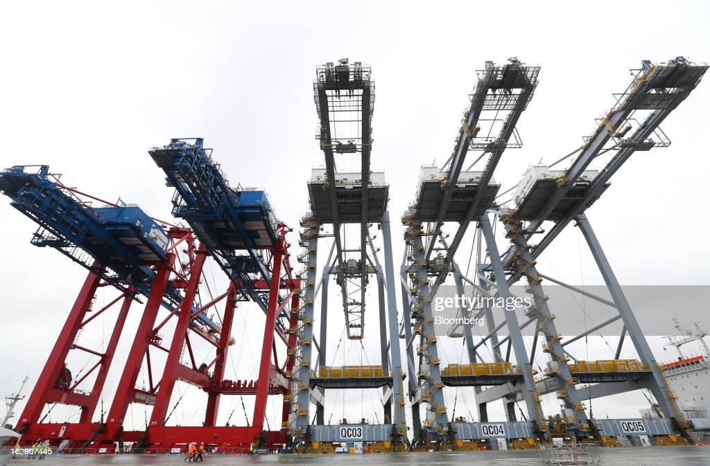 Ship-to-shore container cranes to stand aboard the Zhen Hua 26, a semi-submersible heavy load carrier operated by Shanghai Zhenhua Heavy Industry Co. Ltd. (ZPMC), as it arrives at the dockside of the new DP World Ltd. London Gateway shipping terminal in Stanford-le-Hope, U.K., on Friday, March 1, 2013. DP World, which operates more than 60 terminals in six continents, said it is on track to open new capacity in Santos in Brazil, Jebel Ali in the United Arab Emirates and London Gateway in the U.K. this year. Photographer: Chris Ratcliffe/Bloomberg via Getty Images
