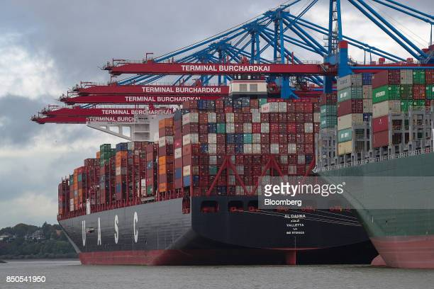 Shiptoshore cranes stand alongside the Al Dahna container ship operated by the United Arab Shipping Co at the Port of Hamburg in Hamburg Germany on...