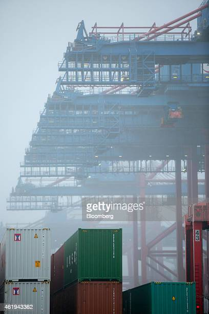 Shiptoshore cranes stand over shipping containers at the Eurogate Container Terminal in the Port of Hamburg in Hamburg Germany on Wednesday Jan 21...