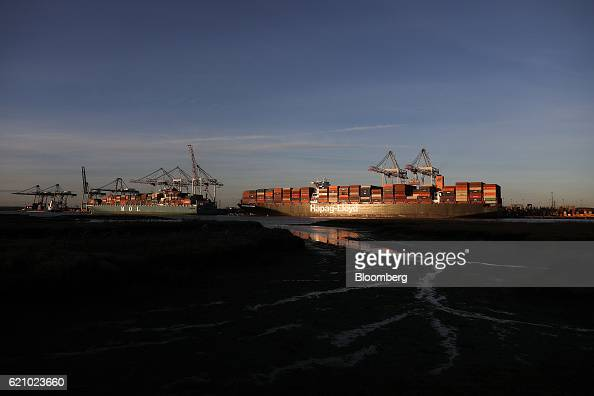 Shiptoshore cranes unload the Ludwigshafen Express container vessel operated by HapagLloyd AG as it sits dockside at the container terminal operated...