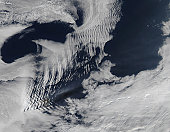 August 20, 2009 - Ship-wave-shaped clouds caused by the presence of the Kerguelen Islands in the South Indian Ocean. This cloud pattern is so-named because it resembles the V-shaped wakes left by movi