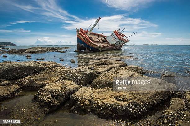Shipwreck near rocky coast