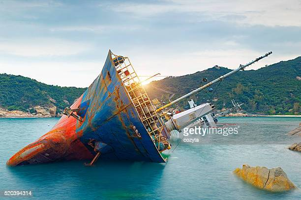 shipwreck or wrecked cargo ship abandoned