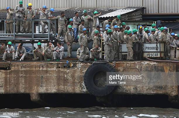 Shipyard workers contracted by Brazil's governmentrun oil company Petrobras gather on February 6 2015 in Niteroi Brazil The chief executive of the...