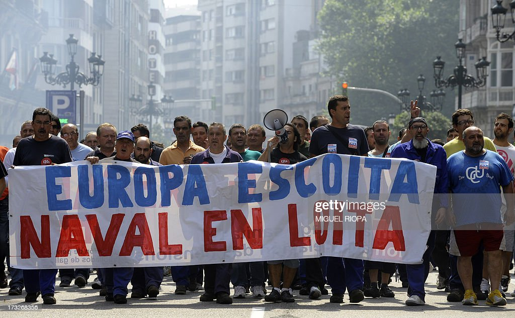 Shipyard workers hold a banner reading 'Listen Europa, shipyard struggles' as they demonstrate during a protest against the repayment of state aids by Spanish shipbuilders in Vigo, on July 11, 2013. Brussels will decide by July 17 if the roughly three billion euros (4.0 billion USD) in state aid which Spanish shipbuilders received between 2005 and 2011 were unauthorised and if they will have to pay the money back. Unions have called for a day of protest and strikes on July 11 when European Union's commissioner for competition, Joaquin Almunia, will meet with representatives of Spanish shipbuilders in Brussels. AFP PHOTO/ MIGUEL RIOPA