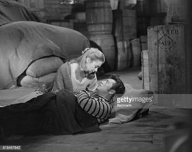 Shirley as the wife of Julie in 'Carousel' comforts Gordon McCrae who plays the role of the husband It's the young actress' second success in a...