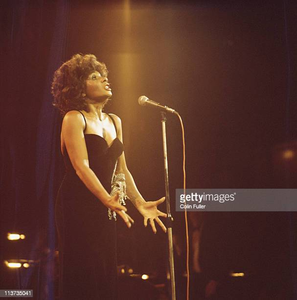 Shirley Bassey British singer singing on stage during a live concert performance at the Royal Albert Hall in London England Great Britain in October...