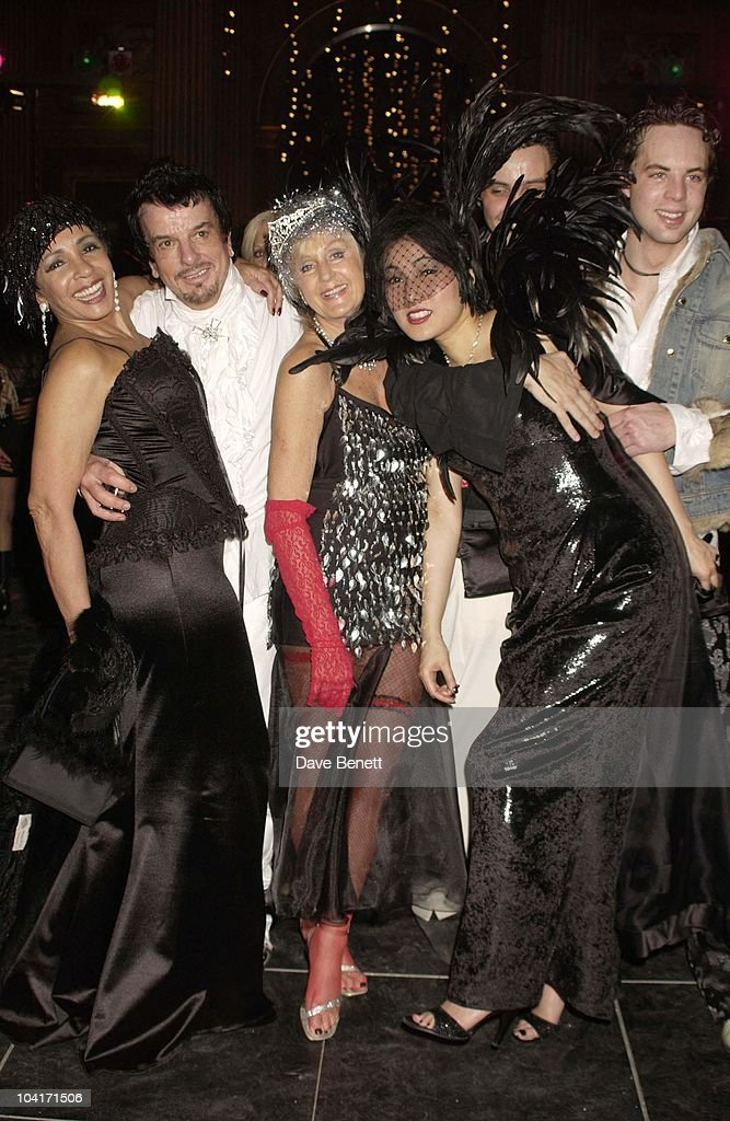 Shirley Bassey, Nicky Haslam, Liz Brewer & Pattie Wong, Hong Kong Financier Andy Wong And His Wife Pattie Throw Their Annual Chinese New Year Party. In Fancy Dress The Dress Code Was Mystery Vamp And Seduction And Most Of Londons Society Turned Up To A Mysterious Event In The Same Theme As 'Eyes Wide Shut' With Masked Young Women With Very Little On, As Prince Andrew Found Out.!
