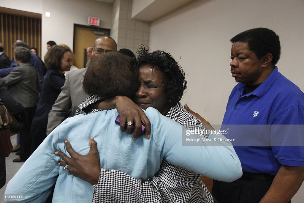 Shirley Burns, center, hugs her friend Margaret Tinsley after Cumberland County Senior Resident Superior Court Judge Greg Weeks found that racial bias played a role in the trial and death row sentencing of Burns' son inmate Marcus Robinson on Friday, April 20, 2012, in Fayetteville, North Carolina. The historic ruling means Robinson's sentence was immediately converted to life without possibility for parole. It was the first case to be decided under the North Carolina's Racial Justice Act.