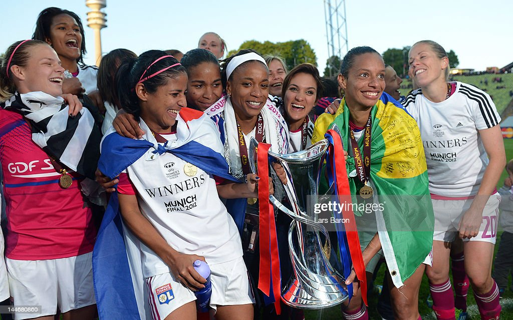Shirley Cruz Trana of Olympique Lyonnais (2nd from left) celebrates with team mates after winning the UEFA Women's Champions League Final at Olympiastadion on May 17, 2012 in Munich, Germany.