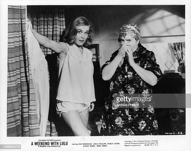 Shirley Eaton standing in night wear looking surprised in a scene from the film 'A Weekend With Lulu' 1961