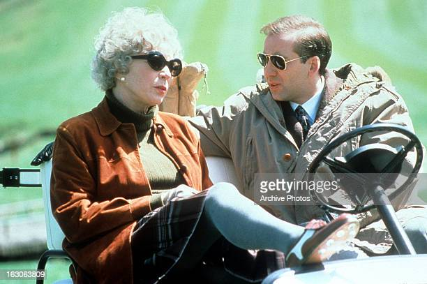 Shirley MacLaine sits in a golf cart with Nicolas Cage in a scene from the film 'Guarding Tess' 1994