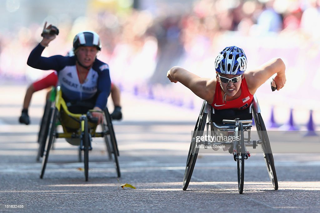 Shirley Reilly of USA crosses the finishing line in the Women's T54 Marathon to win gold from Shelly Woods of Great Britain on day 11 of the London...
