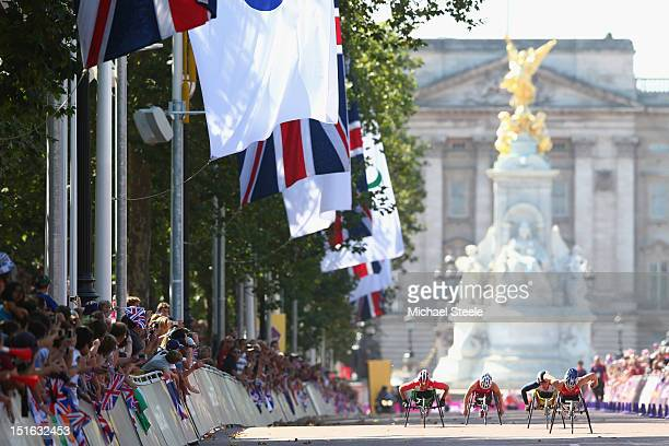 Shirley Reilly of USA heads down The Mall towards victory in the Women's T54 Marathon from Shelly Woods of Great BritainAmanda McGrory of USA and...