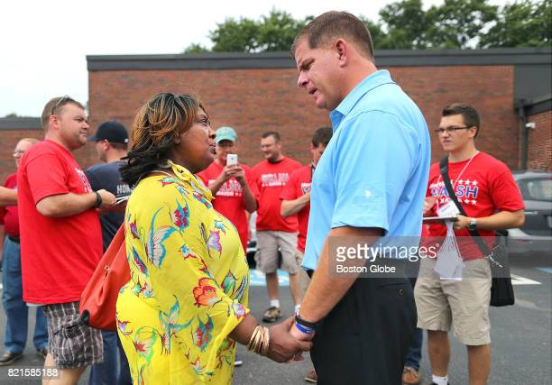 Shirley Shillingford chats with Boston Mayor Marty Walsh as he kicks off his campaign for reelection outside Florian Hall in Boston's Dorchester...