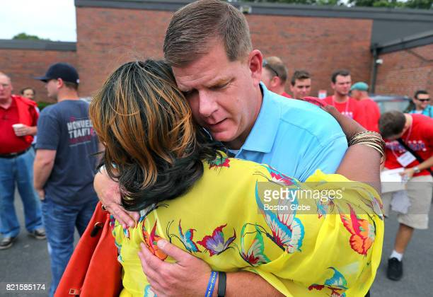 Shirley Shillingford hugs Boston Mayor Marty Walsh as he kicks off his campaign for reelection outside Florian Hall in Boston's Dorchester...