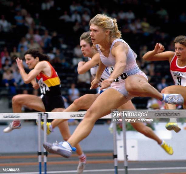 Shirley Strong of Great Britain enroute to placing first for the sixth consecutive time in the women's 100 metres hurdles during the AAA...