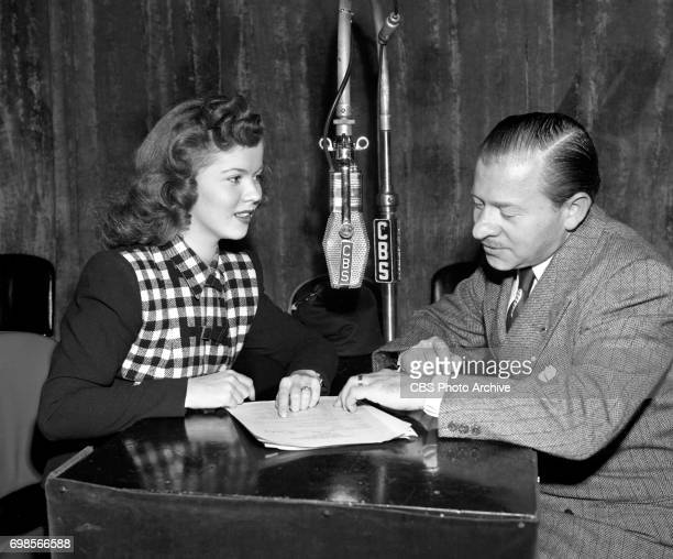 Shirley Temple confers with producer Charles Vanda during rehearsal for The Cradle Song on the CBS Radio program Theater of Romance Image dated...