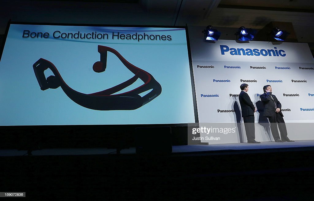 Shiro Kitajima (R), President of Panasonic Consumer Marketing Company of North America, demonstrates Bone Conduction Headphones at a Panasonic press conference during the 2013 International CES at the Mandalay Bay Convention Center on January 7, 2013 in Las Vegas, Nevada. CES, the world's largest annual consumer technology trade show, runs from January 8-11 and is expected to feature 3,100 exhibitors showing off their latest products and services to about 150,000 attendees.