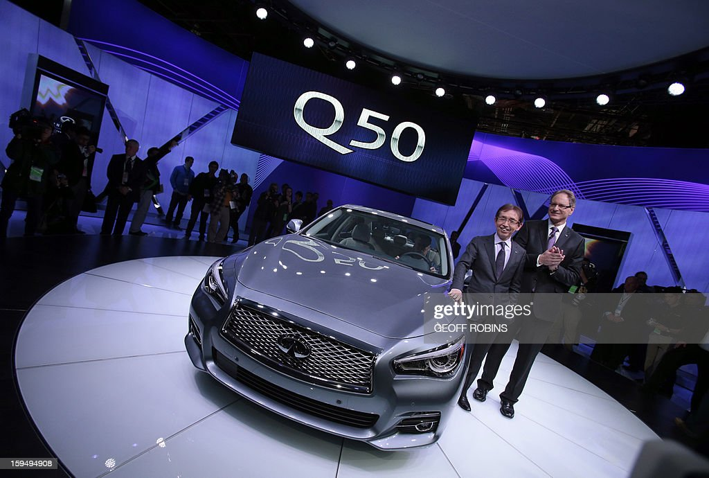 Shiro Nakamura, Chief Executive Officer for Infiniti, and Johan Nysschen, President of Infiniti, pose with the new Infinity Q50 luxury sports car at the 2013 North American International Auto Show in Detroit, Michigan, January 14, 2013. AFP PHOTO/Geoff Robins