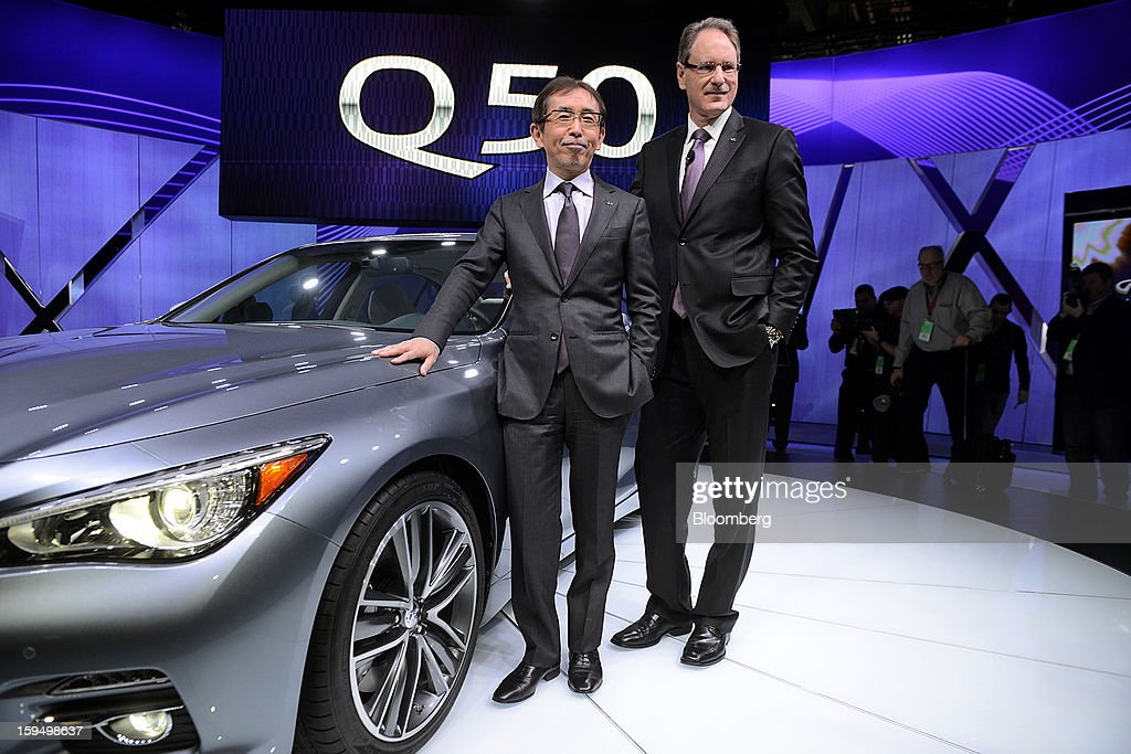 Shiro Nakamura, senior vice president of Nissan Motor Co., leftm and Johan De Nysschen, president of Infiniti for Nissan Motor Co., stand for a photograph in front of the Q50 sedan during the 2013 North American International Auto Show (NAIAS) in Detroit, Michigan, U.S., on Monday, Jan. 14, 2013. Nissan Motor Co.'s Infiniti, lagging larger German, Japanese and U.S. luxury brands, is replacing the G sedan with the Q50 sports car as the company links growth goals for its rechristened lineup to better looks and technology. Photographer: Daniel Acker/Bloomberg via Getty Images