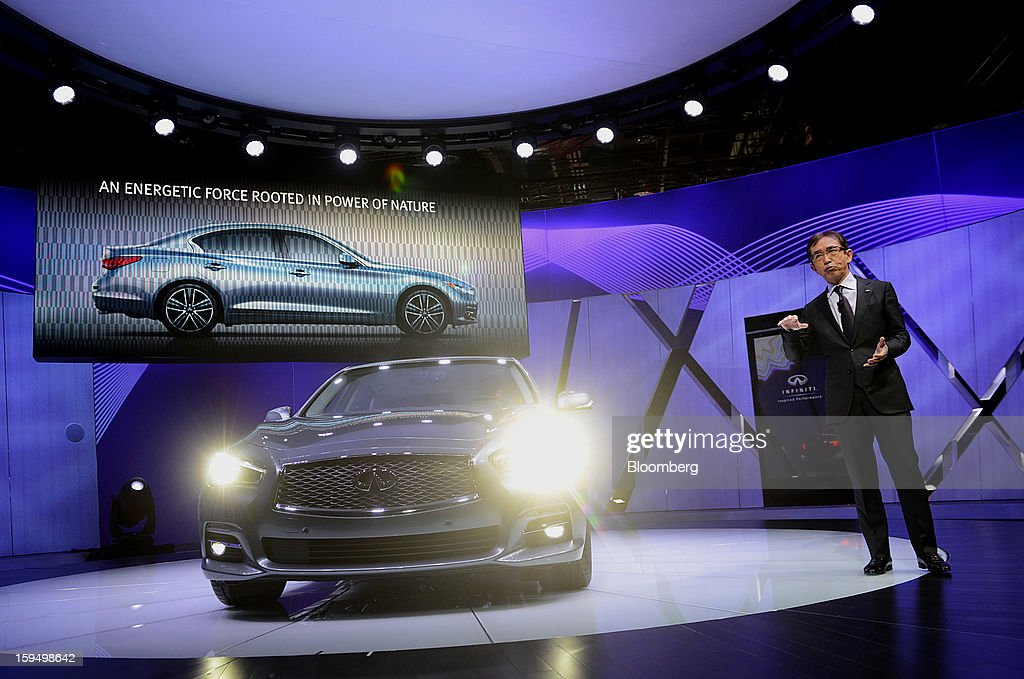 Shiro Nakamura, senior vice president of Nissan Motor Co., speaks during the unveiling of the Infiniti Q50 sedan at the 2013 North American International Auto Show (NAIAS) in Detroit, Michigan, U.S., on Monday, Jan. 14, 2013. Nissan Motor Co.'s Infiniti, lagging larger German, Japanese and U.S. luxury brands, is replacing the G sedan with the Q50 sports car as the company links growth goals for its rechristened lineup to better looks and technology. Photographer: Daniel Acker/Bloomberg via Getty Images