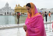 Shiromani Akali Dal MP from Bathinda Harsimrat Kaur Badal paying obeisance at Golden Temple on March 11 2014 in Amritsar India PPP Chief who entered...