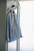 Shirt and tie hang on wardrobe